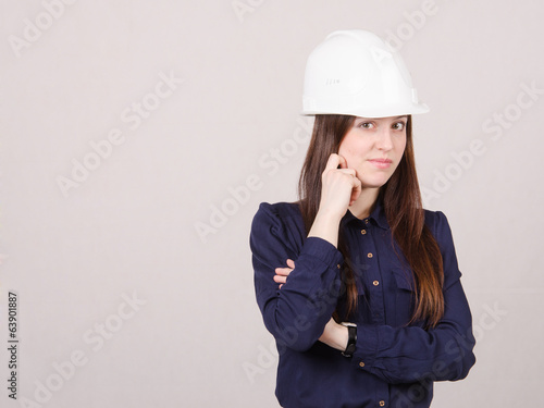 Portrait of pensive girl in a helmet