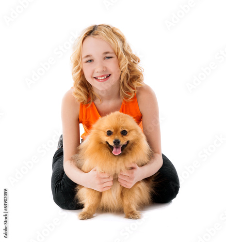 little smiling girl holding her dog