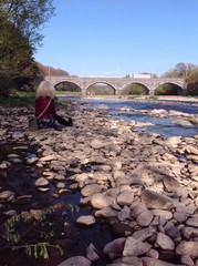 woman sitting by river