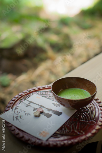 Japanese green tea setting on wooden bench.