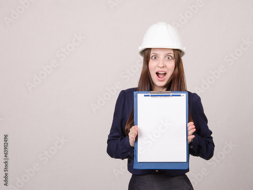 Girl shocked by inscription on sheet in folder