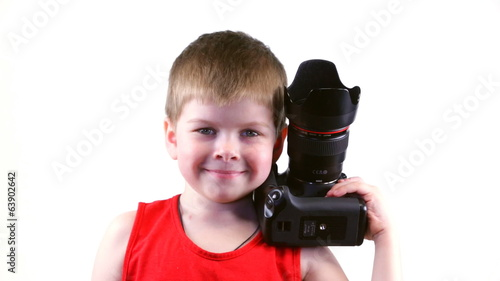 Boy in a red shirt photographs