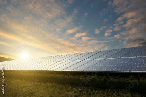 solar panels under sky on sunset
