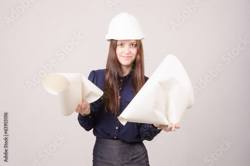 Woman architect in helmet drawing tears