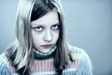 Portrait of a unhappy teen girl
