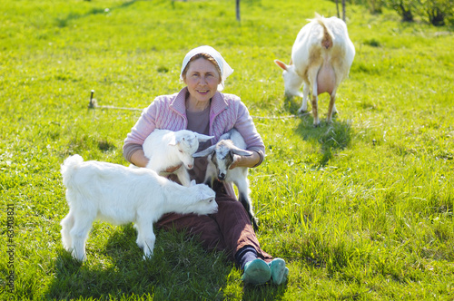 young goats and woman