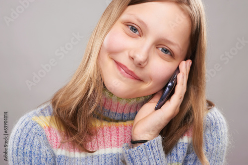 Portrait of a cute teen girl with phone