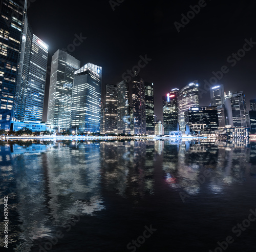 Singapore skyline night panorama. Modern urban city view
