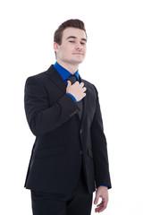 Geschäftsmann blickt voller Stolz herab