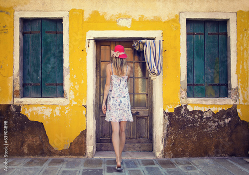 Woman and old house