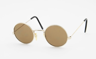 Retro round sunglasses on white background