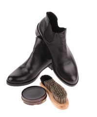 black boots with shoe brush