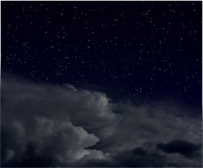 Stars in the night sky with clouds