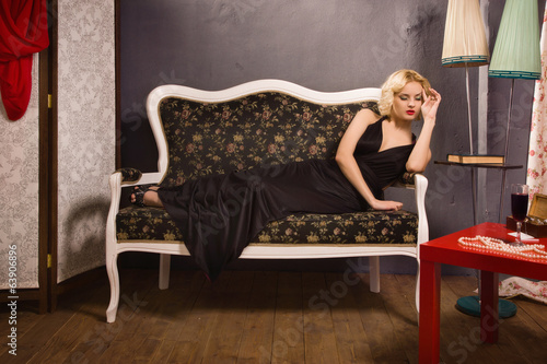 Sensual blonde in the vintage interior