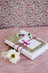 Old notebook with a white flowers for love notes