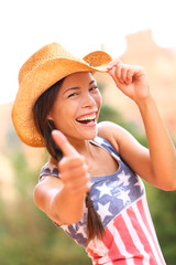 American cowgirl woman happy excited thumbs up