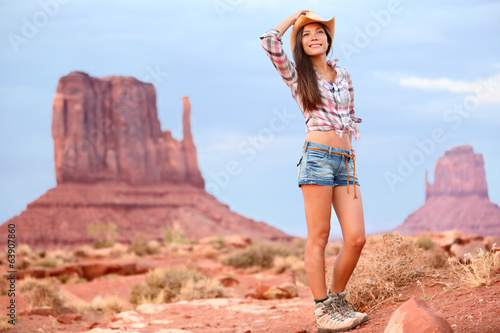 Cowgirl woman tourist travel in Monument Valley