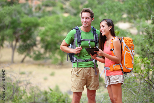 Tablet computer - couple hiking using internet app