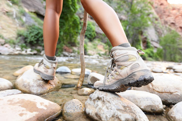 Hiking shoes on hiker outdoors walking