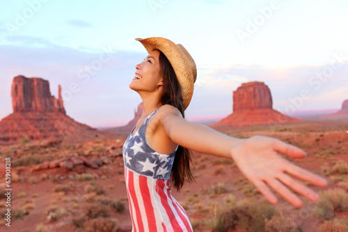 Cowgirl - woman happy and free in Monument Valley