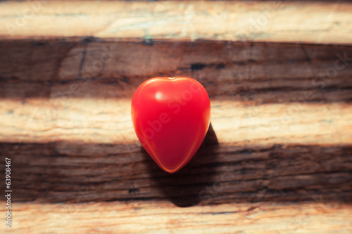 Unusual heartshaped tomato on wood table