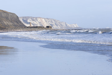 Rough see and white waves at Folkestone beach looking out to Dov