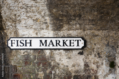 Fish market sign on brickwork bridge