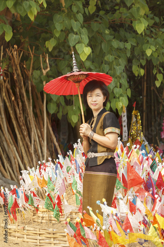 Woman with religion flag at temple in Songkran festival