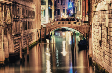 VENICE, ITALY - MAR 23, 2014: Bridge of Sighs at night with tour