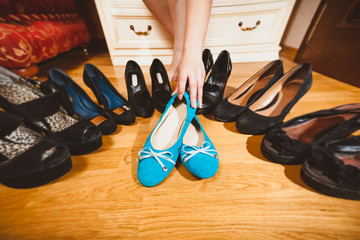 woman picking ballet flats rather than high heels