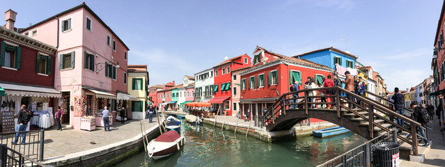 BURANO, ITALY - MAR 19, 2014: Colourful homes of the small city.
