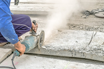 Paving stone saws working with power tools  Stock Photo: