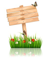 Nature background with green grass and flowers and wooden sign V