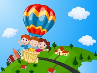 Happy kids riding a hot air balloon