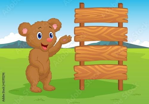 Cartoon baby bear with wooden sign