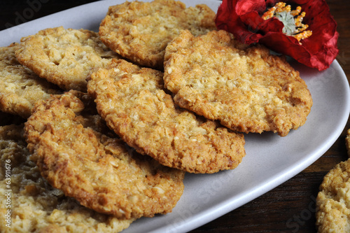 Traditional Anzac biscuits on dark recycled wood
