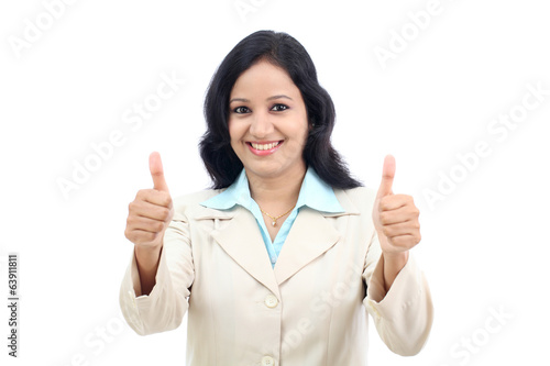 Smiling businesswoman showing thumbs up isolated against white b