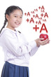 Student girl hold red apple