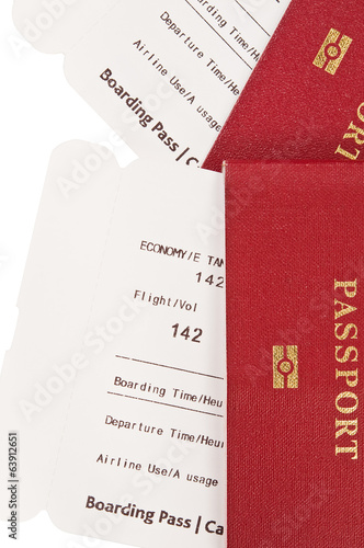 Two passports with airplane boarding passes inside.