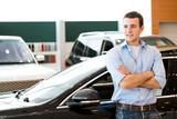 man standing near a car