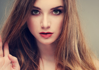 Beautiful  girl, isolated on a light-grey, emotions, cosmetics