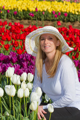 Beautiful woman in the tulip field