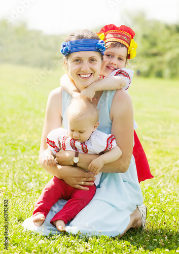 happy  woman with  children in  folk clothes