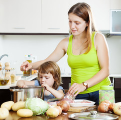 woman with child making soup