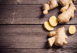 Ginger root sliced on wooden background - 63914831