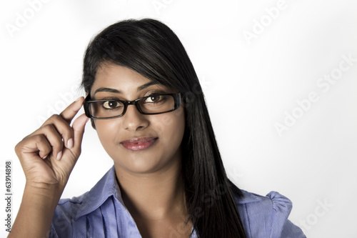 Gorgeous Indian woman hold her framed glasses