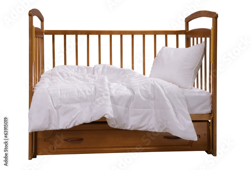 Wooden cot with bedding isolated on white background