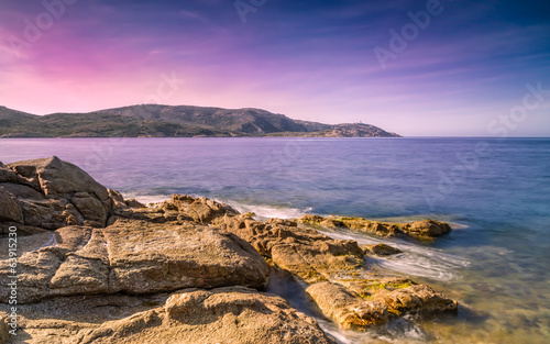 Purple evening sky over Revellata lighthouse in Corsica