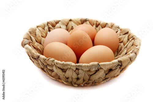 Eggs in a wattled basket  isolated