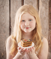smile girl with cake on wooden background